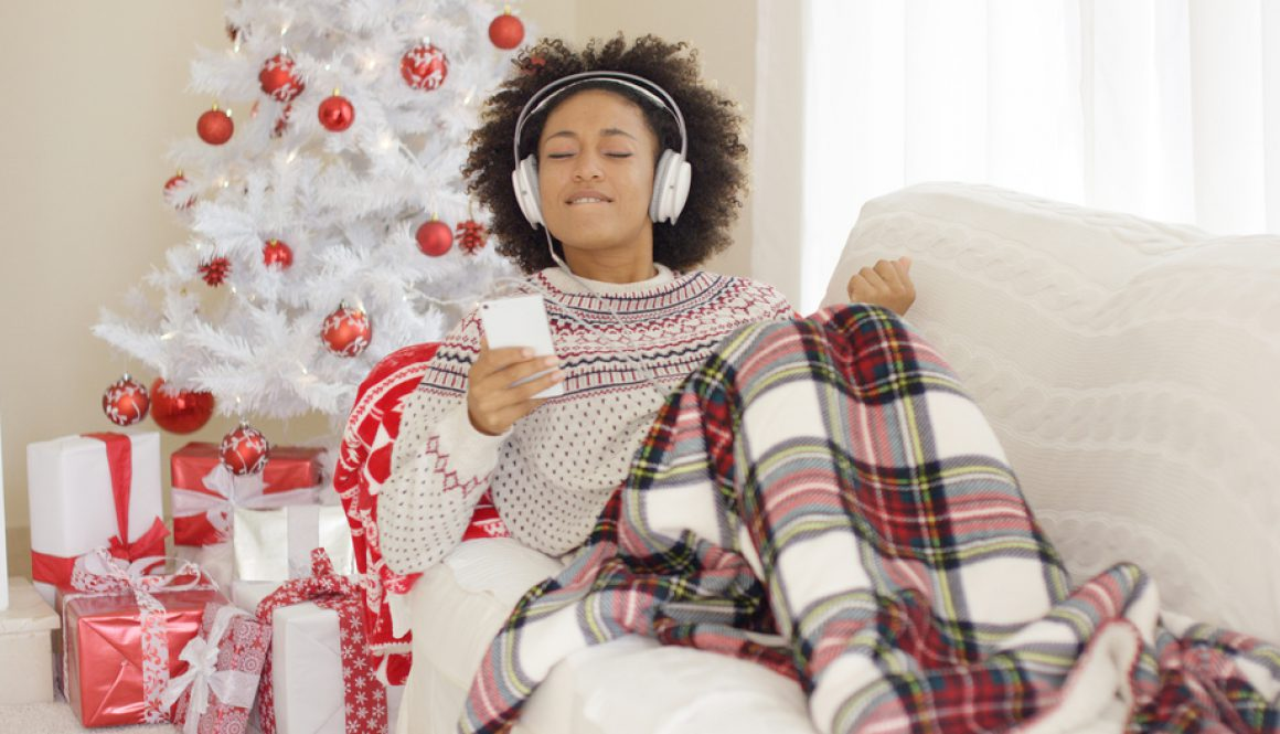 Woman listening to music at Christmas